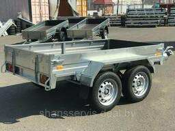 Двухосный прицеп ССТ-7132-18, размером 2. 42х1. 44, г/п 2110 кг, с тормозной системой. ..