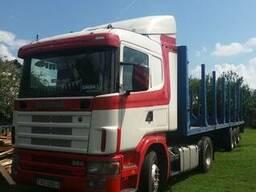 Доставка леса лесовозом Scania