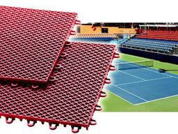 Пластиковое спортивное покрытие с укладкой на грунт.