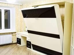 Шкаф-кровать с подъемным спальным местом.
