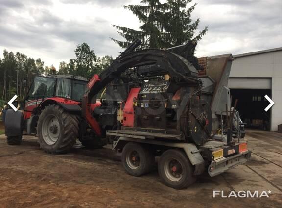 Трактор с дробилкой